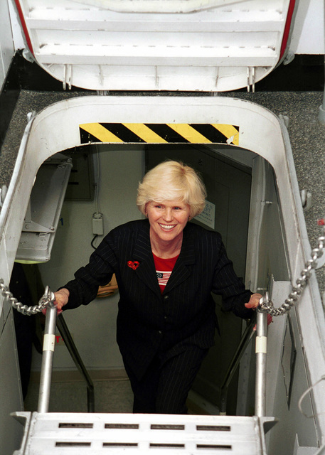 Mrs. Carolyn Shelton, wife of General Henry Shelton (not shown), Chairman Joint Chiefs of STAFF, navigates a ship's ladder on board USS HARRY S. TRUMAN (CVN 75) during a visit with her husband to meet and address the crew. Truman is on station in the Persian Gulf in support of Operation SOUTHERN WATCH