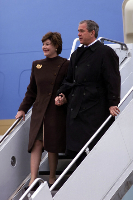 US President George W. Bush and Mrs. Laura Bush arrive at Langley Air Force Base, Virginia, on their way to the christening ceremony of the USS RONALD REAGAN (CVN 76) (not shown) at Newport News Shipbuilding, Virginia