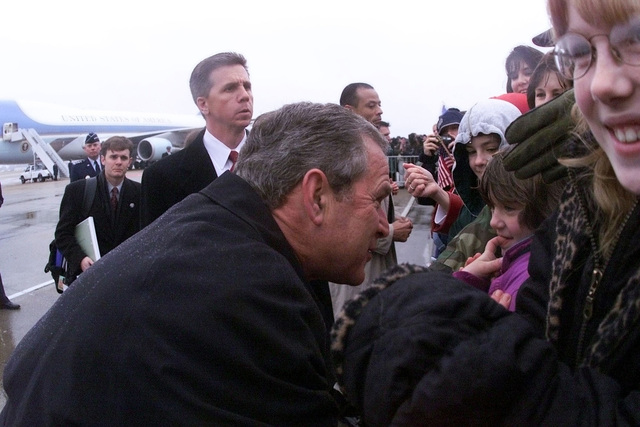 US President George W. Bush greets the daughter of US Air Force MASTER Sergeant Kenneth Reinhart on his brief visit to Langley Air Force Base, Virginia. The President is enroute to attend the christening of the USS RONALD REAGAN (CVN 76) (not shown) at Newport News Shipbuilding, Virginia