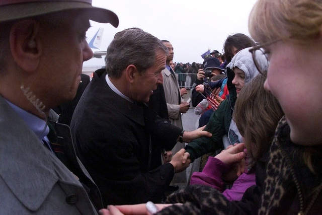 US President George W. Bush greets the son of US Air Force MASTER Sergeant Kenneth Reinhart on his brief visit to Langley Air Force Base, Virginia. The President is enroute to attend the christening of the USS RONALD REAGAN (CVN 76) (not shown) at Newport News Shipbuilding, Virginia