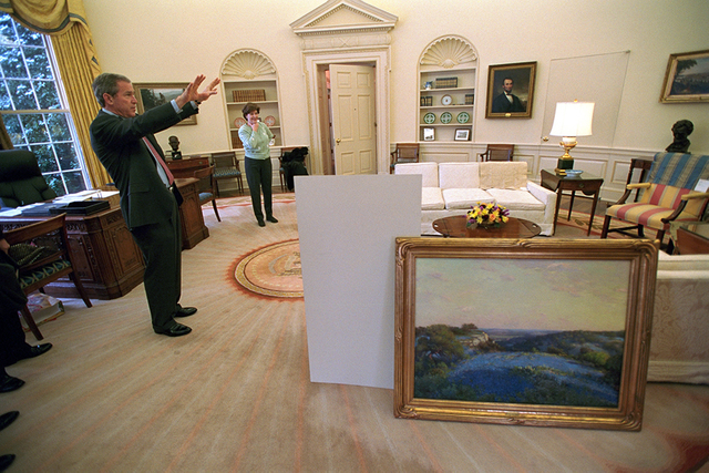 President George W. Bush and Mrs. Laura Bush Decorate the Oval Office