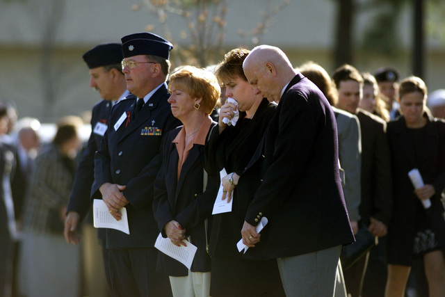 Family and friends of 18 Virginia Air National Guard and three Florida Army National Guard members killed in a March 3rd C-23 Sherpa plane crash in Unadilla, Georgia, gather to pay tribute to the men at a memorial service in Virginia Beach, Virginia. The memorial, which took place at Rock Church, was attended by Deputy Secretary of Defense, Paul D. Wolfowitz (not shown) and various other civilian and military dignitaries and over 4000 members of the community. The 18 airmen were assigned to the 203rd Red Horse Flight at Camp Pendleton State Military Reservation in Virginia Beach, Virginia and were returning from temporary duty at Hurlburt Field, Florida. The three soldiers were assigned ...