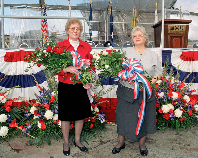 Mrs. Arlene May Pomeroy Castle, ships sponsor, and Ms Nancy Pomeroy, maid of honor, pose for a photographer prior to the christening and launch of the Military Sealift Command (MSC), strategic heavy lift ship USNS POMEROY (T-AKR-316)