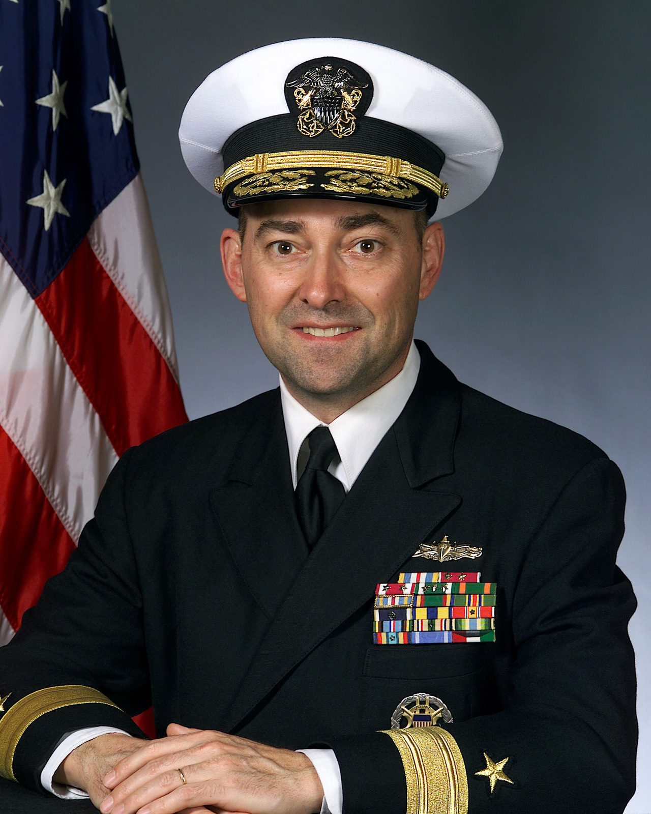 Portrait of US Navy Rear Admiral (lower half) James G. Stevridis. (covered)
