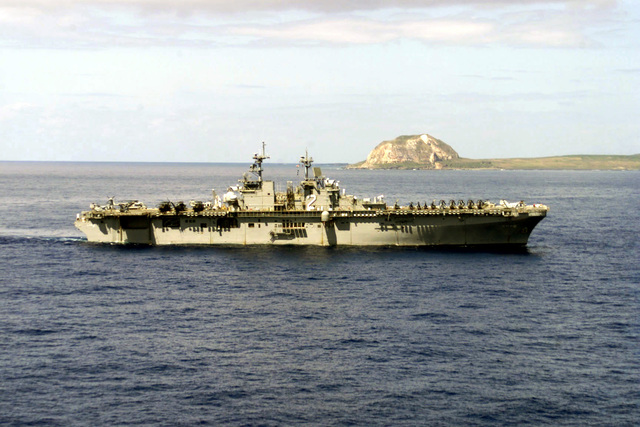 An aerial starboard view of the amphibious assault ship USS Essex (LHD 2) off the coast of Iwo Jima with Mount Suribachi in the backgroud. ESSEX is off the coast of Iwo Jima participating in the 56th Iwo Jima Commemoration on March 15, 2001
