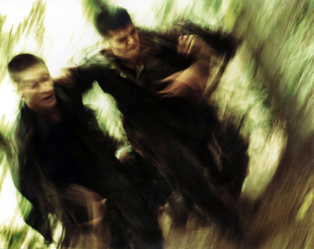 Military Photographer of the Year, Honorable Mention, The foliage of the wilderness became a blur as these two midshipmen pressed on through the woods with yet another mile to go in their 5-mile forced hike