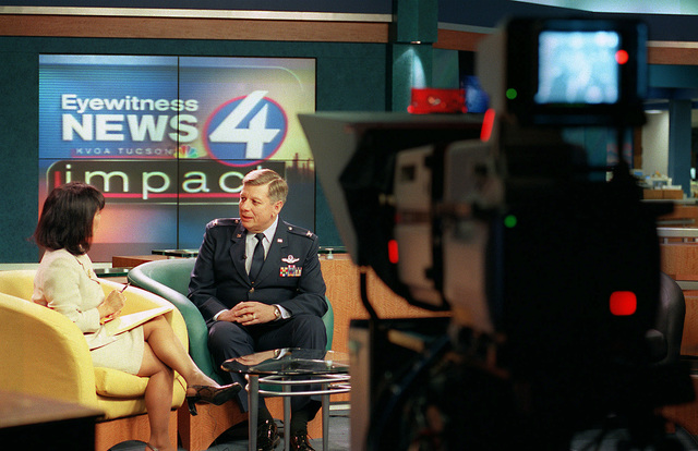 The 162nd Fighter Wing, Tucson, Arizona, Air National Guard Commander, Colonel Ronald E. Shoopman, USAF, interviewed by Lupita Murillo, news anchor during the taping of KVOA Eyewitness News 4, local news program. The program highlights individuals who impact the community with either their professional or personal contributions