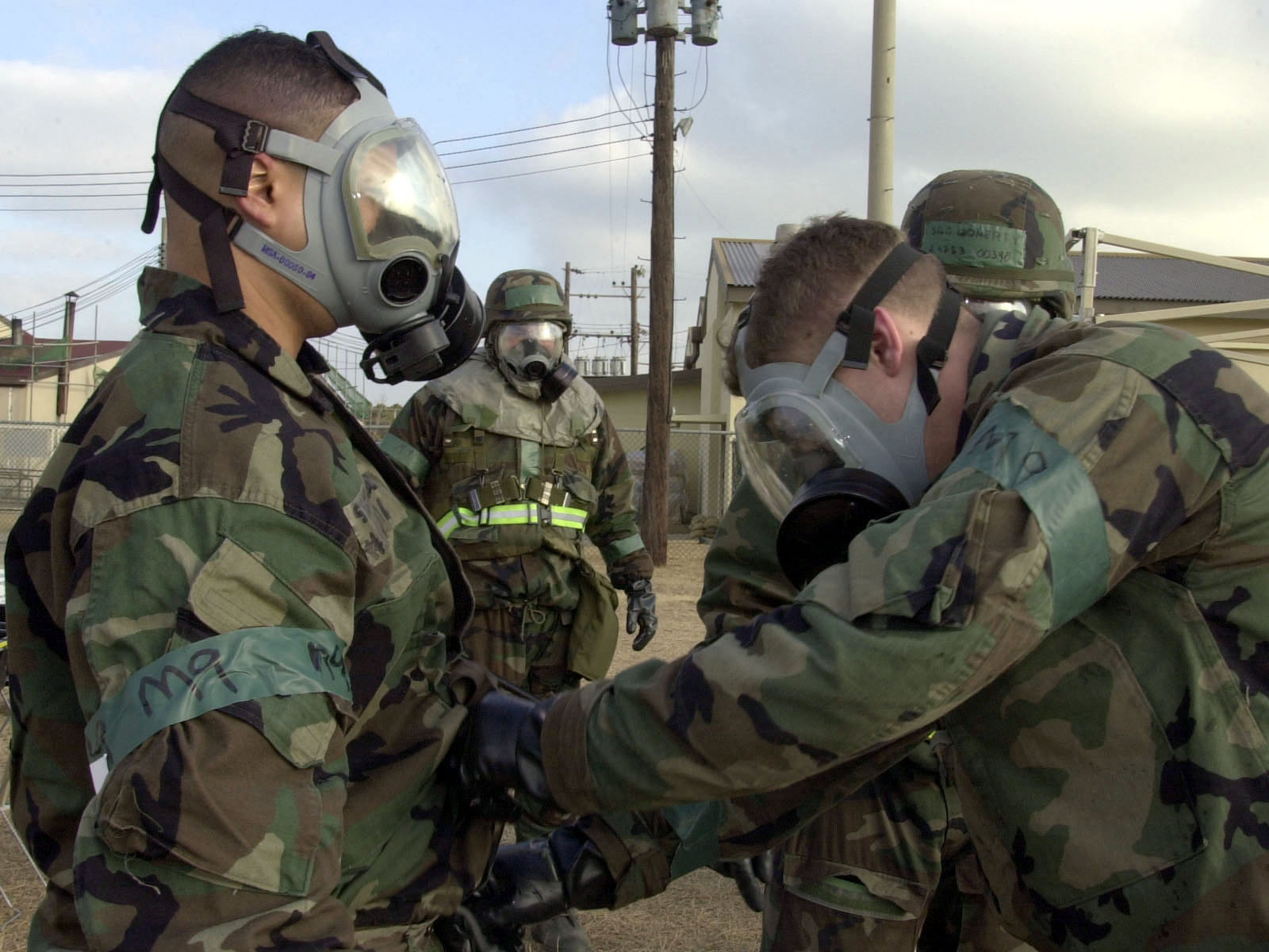 US Air Force Airmen of the 8th Fighter Wing, Kunsan Air Base, Republic of Korea Wing help each other takeoff the contaminated over-garments of their Mission-Oriented Protective Posture response level 4 (MOPP-4) gear at the Contaminant Control Area during their Operational Readiness Inspection (ORI). The 8th Fighter Wings personnel are being evaluated on their wartime capabilities during their ORI