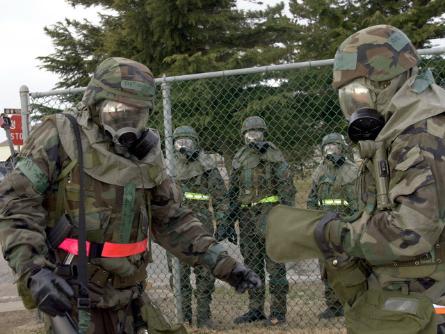 US Air Force STAFF Sergeant Brian Gracey, 8th Communications Squadron, Kunsan Air Base, Republic of Korea wears his Mission-Oriented Protective Posture response level 4 (MOPP-4) gear as he arrives at Station 1 of the 11 Personnel Decontamination Stations, inside the Contaminate Control Area during the 8th Fighter Wing's Operational Readiness Inspection (ORI). The 8th Fighter Wing personnel are being evaluated on their wartime capabilities during their ORI