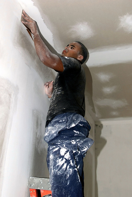 US Air Force AIRMAN First Class Julio Cruz, from the 820th Red Horse Squadron, Nellis Air Force Base, Nevada, does the final finishing before painting is done at the new barracks in Castries, Saint Lucia, in support of Exercise NEW HORIZONS. Approximately 100 Army, Marine, and Air Force personnel are deployed to Saint Lucia as part of New Horizons. The excercise has a two fold mission of readiness training, and humanitarian assistance in the Caribbean and Latin America
