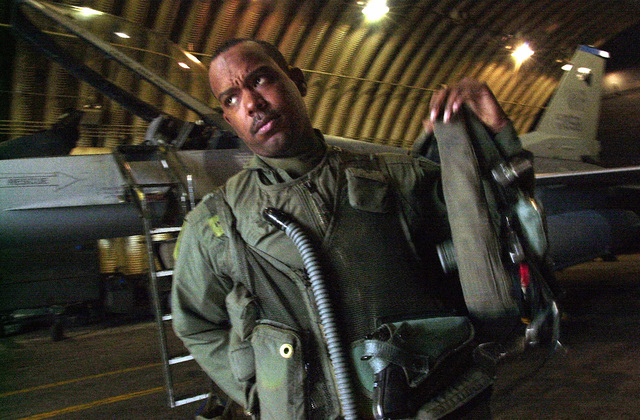 US Air Force Captain Terrence Hedley, a pilot assigned to the 35th Fighter Squadron, 8th Fighter Wing (FW), Kunsan Air Base, Republic of Korea, gears up before a mission. Members of the 8th FW were being tested on their war fighting skills during the recent Beverly Bearcat Operational Readiness Inspection