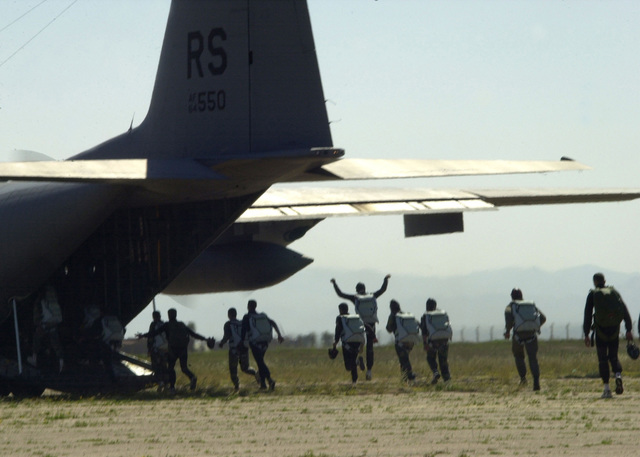 Moroccan Army paratroopers hurry to board a US Air Force C-130 Hercules aircraft at Ben Guerir AirField, Morocco. Morocco Army Soldier trained in High Altitude Low Open (HALO) drops during Operation BULE SANDS 2001