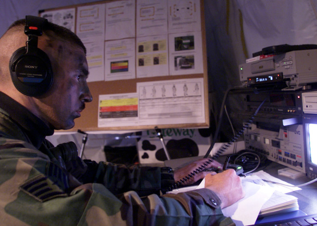 US Air Force STAFF Sergeant Lester Finuf, 1ST Communications Squadron, Videographer, uses a digital editing system to edits video footage for the daily product to be used by Public Affairs, during the Operational Readiness Inspection at Langley AFB, VA