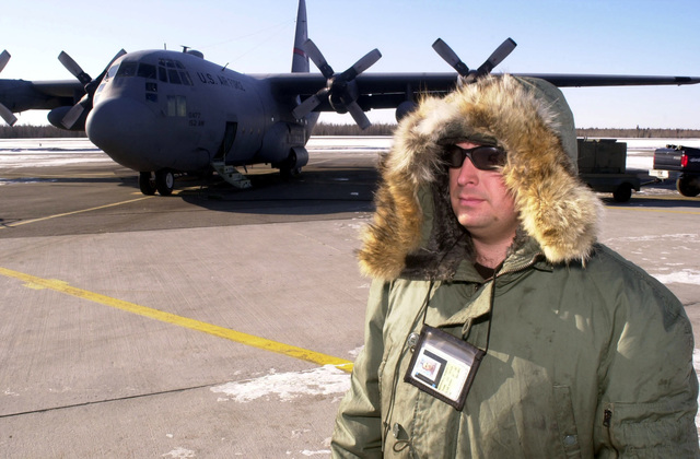 Technical Sergeant Terry Marshall a crew chief with the 152nd Air Wing, Nevada Air National Guard stands on the flight line during Exercise NORTHERN EDGE 2001. TSGT Marshalls aircraft a modified C-130 Hercules is parked in the background and will fly the Scathe View system mission. The Scathe View system allows aircraft to acquire imagery up to 17,000 ft off the ground and can instantly transmit the imagery to ground forces