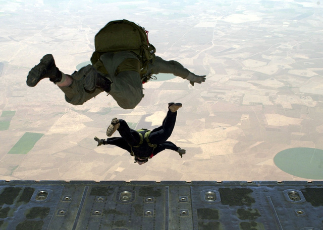 Two Paratroopers of the 123rd Special Tactic Squadron, Louisville, Kentucky jump out the back of a C-130 Hercules aircraft, during a High Altitude Low Open (HALO) drop on Ben Guerir Airfield, Morocco, part of Operation BLUE SANDS 2001