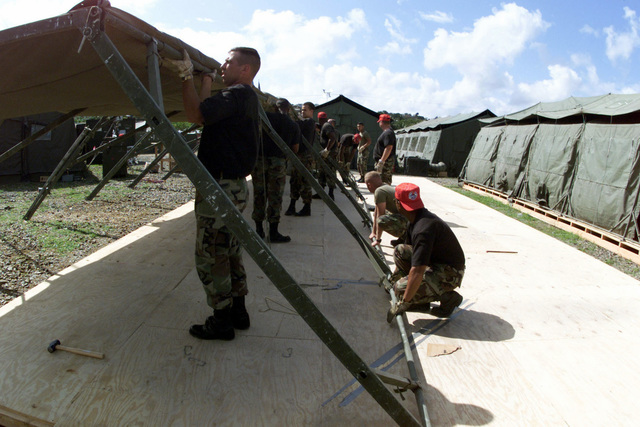 US Air Force Airmen of the 820th RED HORSE Squadron, Nellis Air Force Base, Nevada take down portable tents used for lodging in Saint Lucia, as they prepare for redeployment back to the United States, at the completion of Exercise NEW HORIZONS 2001. The Exercise provided much needed humanitarian assistance to impoverished nations throughout South and Central America, while providing unique and valuable training to active duty and reserve components of the US Military