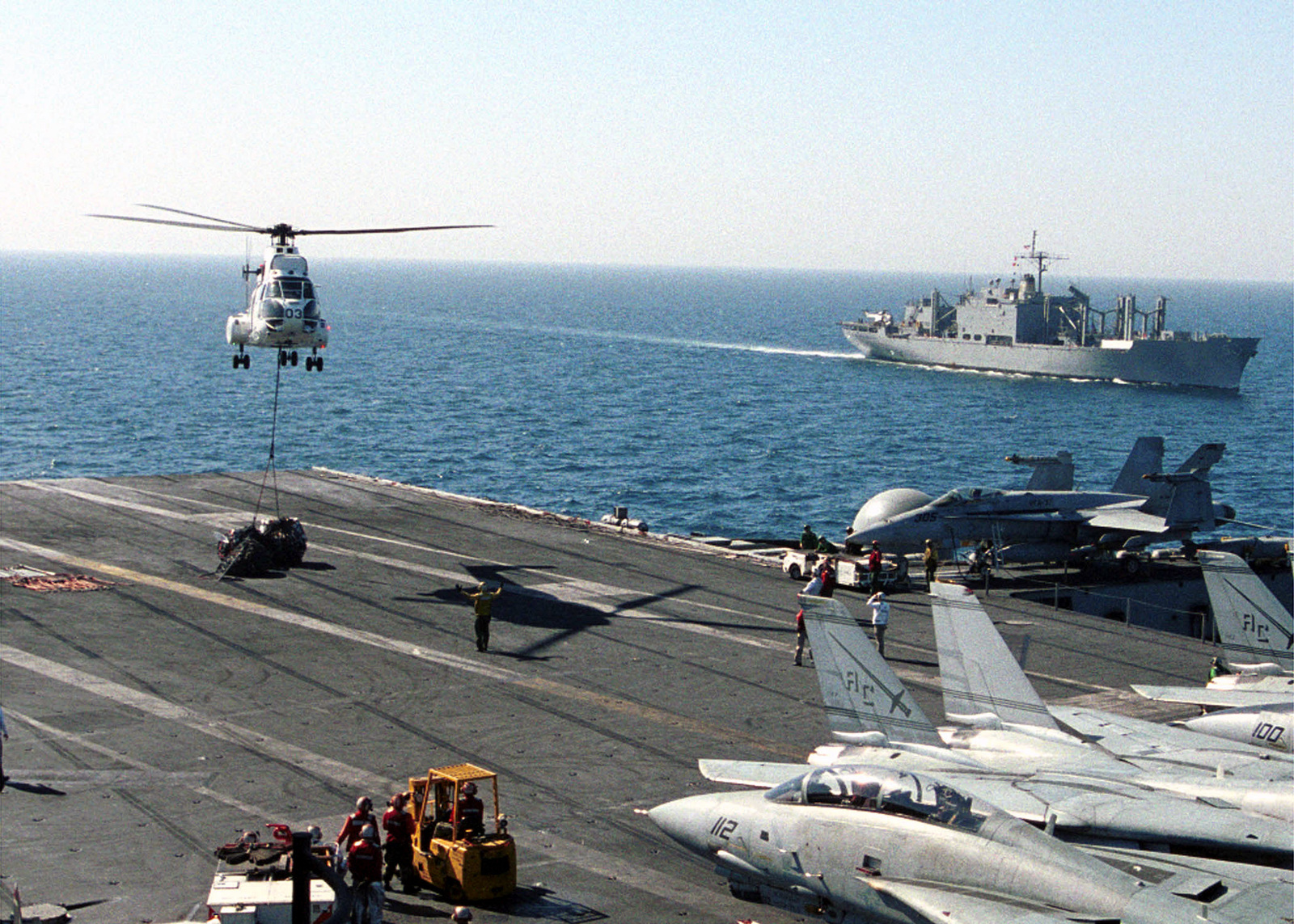 A SA-330 Puma helicopter assists in transporting stores between USNS Concord (T-AFS 5) and USS Harry S. Truman (CVN 75) during a vertical replenishment (VERTREP) at sea. TRUMAN is on station in the Arabian Gulf in support of Operation SOUTHERN WATCH. SOUTHERN WATCH establishes a southern no fly zone over Iraq and extends to the borders to just south of Baghdad, capital city of Iraq