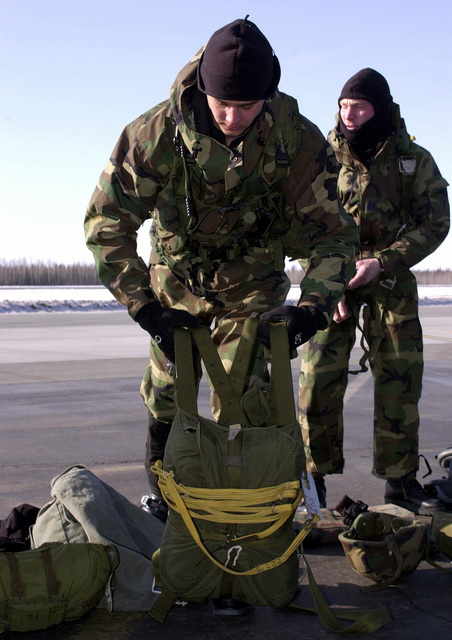 Combat control, team leader, US Air Force First Lieutenant Jason Daniels, of the 22nd Special Tactics Squadron, McChord Air Force Base, Washington, gears up for a jump master inspection before boarding an Air National Guard C-130 Hercules aircraft (not shown) for a jump during Exercise NORTHERN EDGE 2001