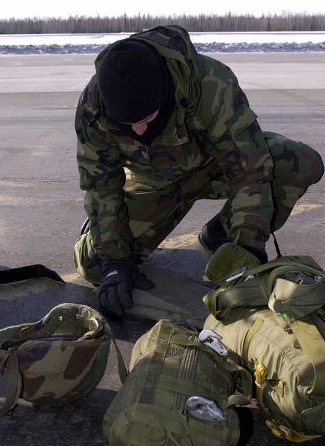 Combat controller, US Air Force Captain Wallpert of the 22nd Special Tactics Squadron, McChord Air Force Base, Washington, gears up for a jump master inspection before boarding an Air National Guard C-130 Hercules aircraft (not shown) for a jump during Exercise NORTHERN EDGE 2001