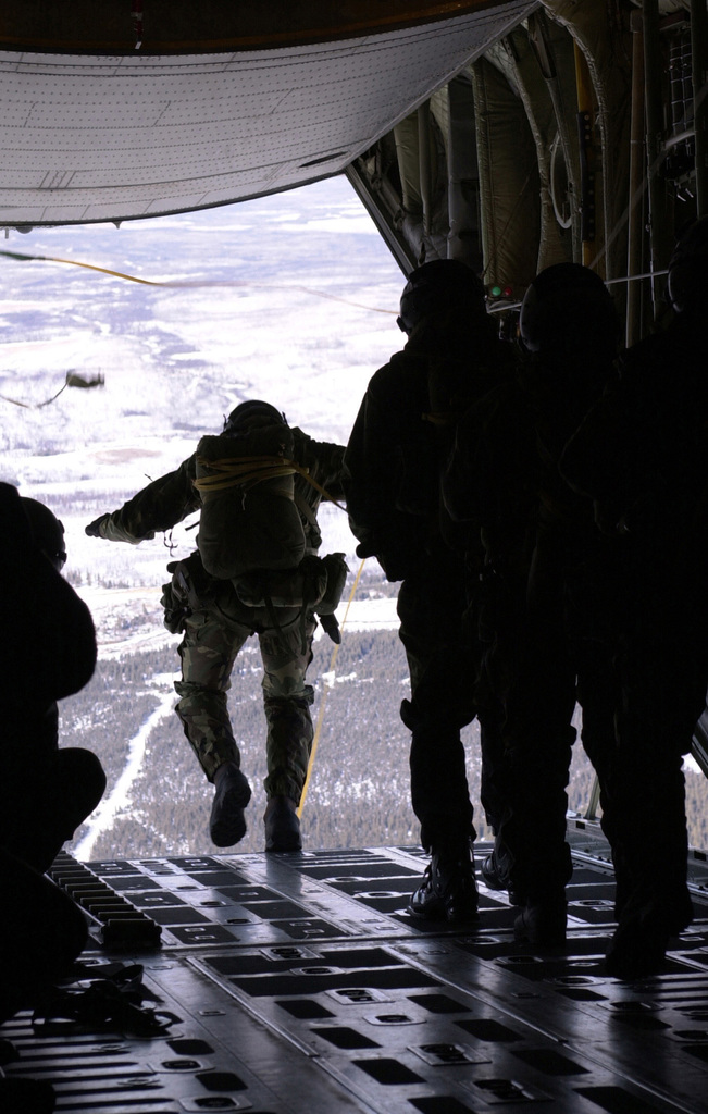 Combat controllers from the 22nd Special Tactics Squadron, McChord Air Force Base, Washington, jump from an Air National Guard C-130 Hercules aircraft during Exercise NORTHERN EDGE 2001