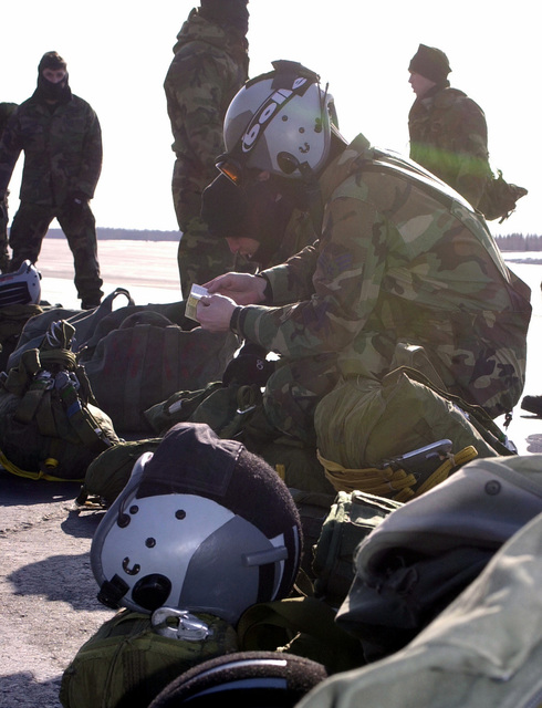 US Air Force Combat controller Matthew Bower, from the 22nd Special Tactics Squadron, McChord Air Force Base, Washington, gears up for a jump master inspection before boarding an Air National Guard C-130 Hercules aircraft (not shown) for a jump during Exercise NORTHERN EDGE 2001
