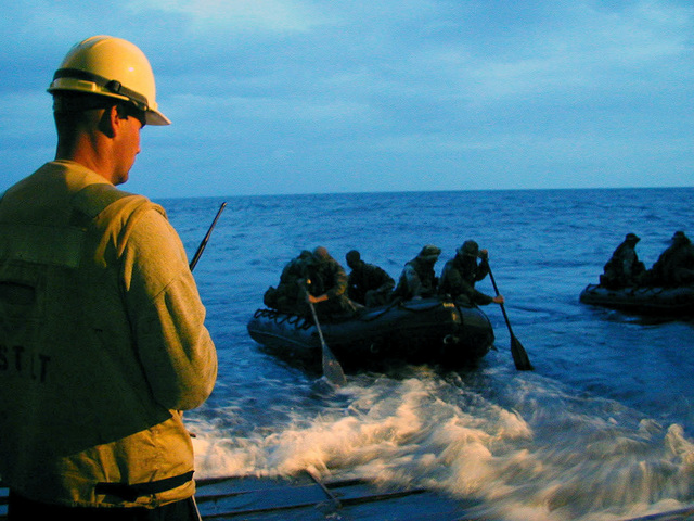 United States (US) Navy and US Marine Corps Explosive Ordnance Disposal (EOD) team members perform a joint raid from the well decks of USS JUNEAU (LPD 10) (not shown) onto the beaches of Okinawa during a Special Operations Capable Certification Exercise (SOCEX 2001) 2001