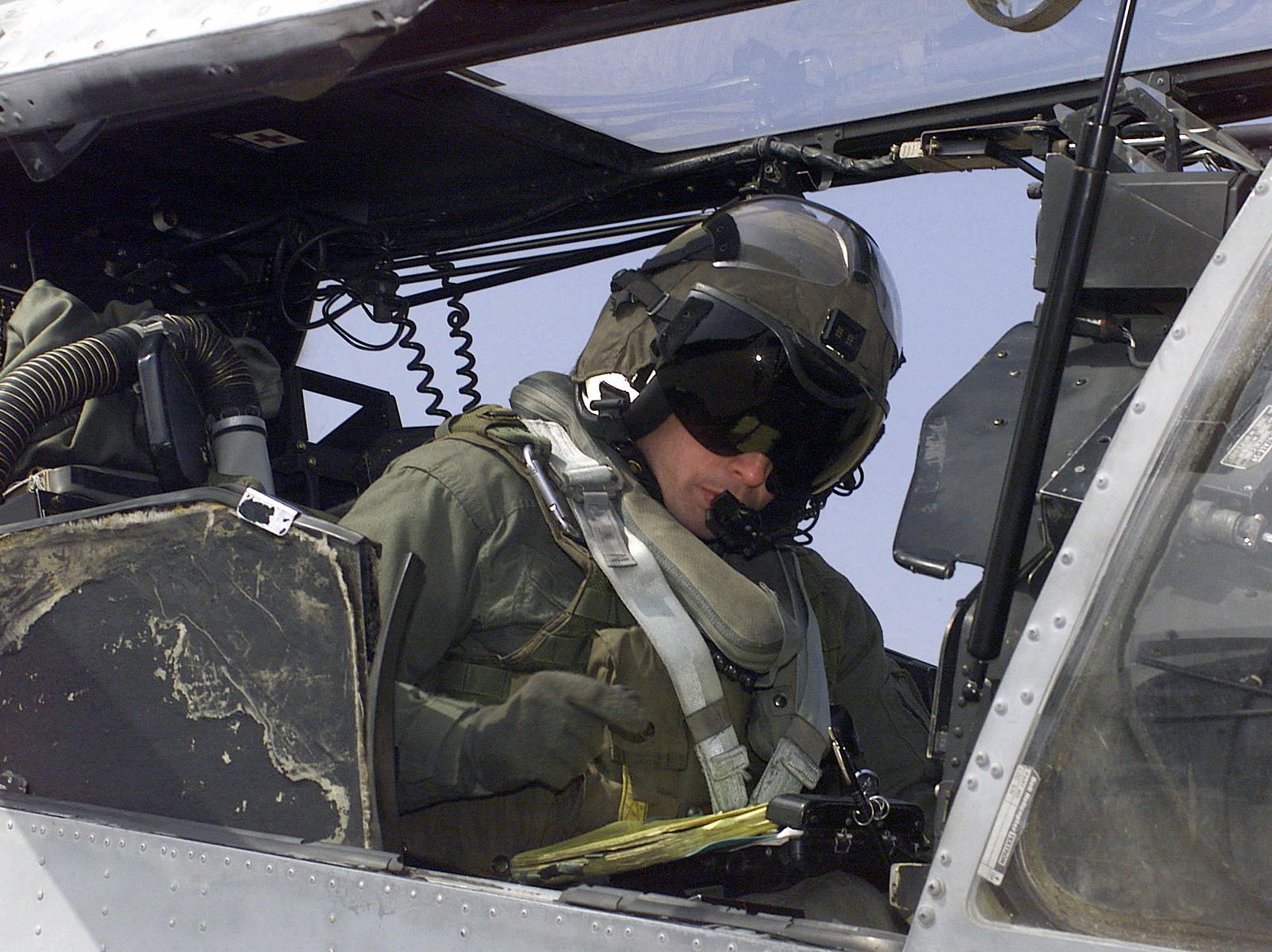 Looking over the last minute details of the days flight, Major John Fitz-Patrick a Marine Light Attack Helicopter Squadron-267 (HMLA-267), Camp Pendleton, California, AH-1W Cobra Helicopter pilot goes down the flight checklist before takeoff during exercise MILLENNIUM EDGE on Osan Air Base, Osan, Korea. MILLENNIUM EDGE is a joint and combined training exercise conducted in the Republic of Korea with assets from Marine and Air Force units. The exercise gives both the pilots and ground crew members a chance to operate in an unfamiliar place with different types equipment