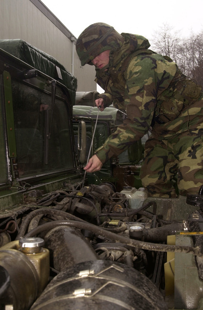 297th Army Infantry Alaskan National Guardman, Private Jed Michaels, a transportation specialist, checks his vehicle for oil before departing on a rendezvous with Alpha Company in support of Exercise NORTHERN EDGE 2001. Northern Edge is Alaska's premier joint training exercise and it lasts for two weeks. Over 10,000 Canadian and United States forces combine to practice protecting Alaska and it's borders