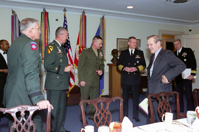 The Honorable Donald H. Rumsfeld (foreground, right), U.S. Secretary of Defense, hosts a meeting with, from the left, U.S. Army GEN. Thomas A. Schwartz, Commander in CHIEF (CINC), United Nations Command, Combined Forces Command (CFC), United States Forces Korea (USFK), GEN. Tommy R. Franks, Commander in CHIEF, U.S. Central Command (CINCENT), U.S. Marine Corps GEN. Peter Pace, Commander in CHIEF, Allied Forces Southern Europe, and U.S. Navy Adm. Dennis C. Blair, Commander in CHIEF, Pacific Command, meet at the at the Pentagon, Washington, D.C., Mar. 27, 2001.  (DoD photo by Helene C. Stikkel) (Released)