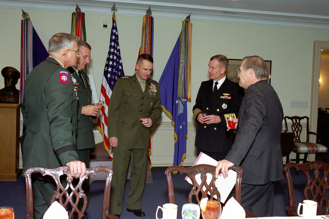 The Honorable Donald H. Rumsfeld (right), U.S. Secretary of Defense, hosts a meeting with, from the left, U.S. Army GEN. Thomas A. Schwartz, Commander in CHIEF (CINC), United Nations Command, Combined Forces Command (CFC), United States Forces Korea (USFK), GEN. Tommy R. Franks, Commander in CHIEF, U.S. Central Command (CINCENT), U.S. Marine Corps GEN. Peter Pace, Commander in CHIEF, Allied Forces Southern Europe, and U.S. Navy Adm. Dennis C. Blair, Commander in CHIEF, Pacific Command, meet at the at the Pentagon, Washington, D.C., Mar. 27, 2001.  (DoD photo by Helene C. Stikkel) (Released)