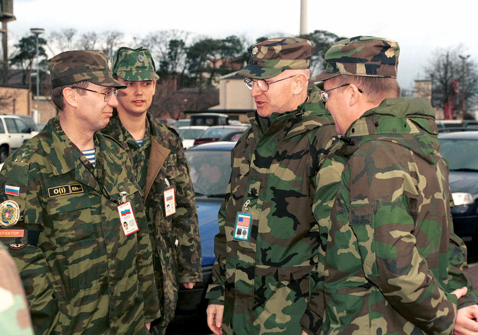 US Air Force Lieutenant Colonel Brad Davis, (center) Defense Threat Reduction Agency (DTRA) Team CHIEF, greets Russian Colonel Aleksandr Migunov, (left) Conventional Armed Forces in Europe (CFE) Team CHIEF, during their arrival at Royal Air Force Lakenheath, United Kingdom