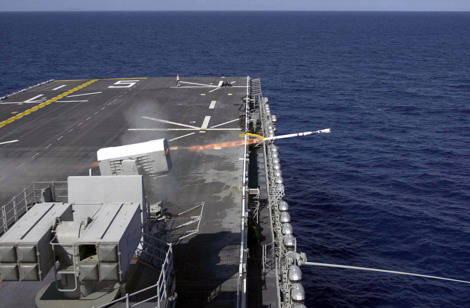 A RIM-116 Rolling Airframe Missile is launched after locking onto its target during a live fire missile exercise on board the USS BATAAN (LHD 5) (Wasp class)