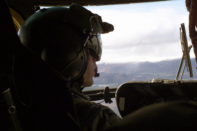 Captain Duban, UASF, MH-53 Pave Low helicopter Pilot assigned to the 100TH Special Operation Group (SOG), Royal Air Force (RAF), Mildenhall, UK flies a reconnaissance mission to the site of the F-15C Eagle aircraft Mishap, located in the Scottish Highlands