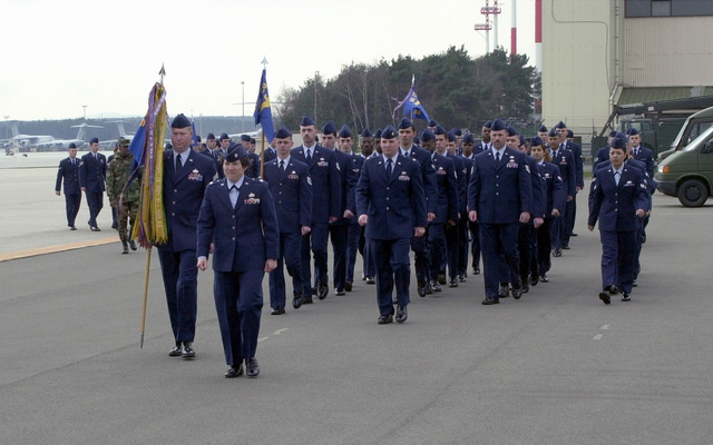 Lieutenant Colonel (LTC), Theresa Bednarek, USAF, Deputy Commander, 86TH Communication Group, Ramstein Air Base, Germany and CHIEF MASTER Sergeant (CMSGT) William Hendley guidon bearer leads her squadron in parade formation during 86th Airlift Wing Retreat Ceremony