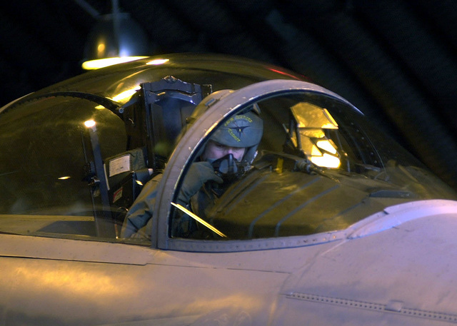 US Air Force Captain Garren Roberts, 493rd Fighter Squadron pilot, performs the preflight check list inside the cockpit of his F-15C Eagle aircraft, inside an aircraft shelter at the 493rd Fighter Squadron, Royal Air Force Lakenheath, United Kingdom