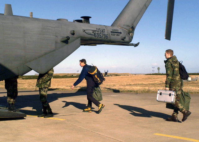 Flight Lieutenant, John Dunn, Royal Air Force (RAF) Mountain Rescue, and STAFF Sergeant (SSGT), Chris Taranto, USAF, Videographer, 48TH Communications Squadron, 48TH Tactical Fighter Wing (TFW), Royal Air Force Lakenheath, UK board a USAF MH-53 PAVE LOW helicopter to conduct a search and rescue mission. Members of the Wing are currently deployed to RAF Kinloss to assist in the search for two downed F-15C Eagle aircraft from the 493rd Tactical Fighter Squadron. The aircraft were reported missing after losing contact in the Scotland Highlands