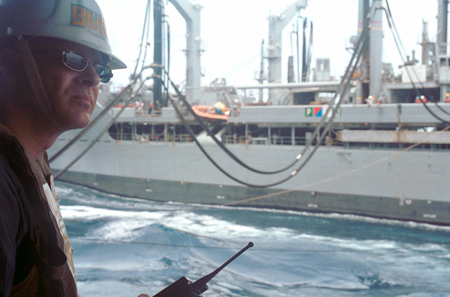 CHIEF Boatswain's Mate (CBM) Richard Stroup from Mount Sterling, Ohio, observes a Connected Replenishment (CONREP) detail between USS KITTY HAWK (CV 63) and the USNS RAPPAHANOCK (T-AO 204)