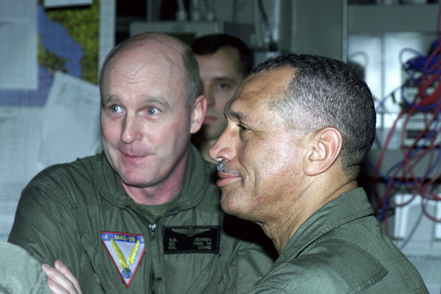 US Marine Corps (USMC) Major General (MGEN) Charles Bolden (right) and USMC Colonel (COL) Jensen, listen during a briefing inside the Operations Center, onboard the USS BONHOMME RICHARD (LHD 6), during Exercise KERNEL BLITZ 2001