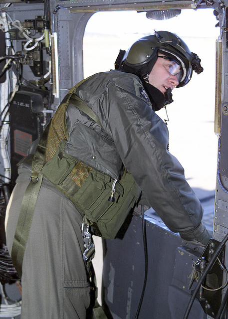 A crewmember aboard a USAF MH-53 PAVE LOW helicopter assigned to the 352ND Special Operations Group (SOG), 21ST Special Operations Squadron (SOS), Royal Air Force (RAF) Mildenhall, UK, mans the crew door during takeoff at RAF Kinloss, Foress Scotland. The helicopter and crew deployed to RAF Kinloss to assist in the recovery of two USAF F-15C Eagle aircraft, that went down during a training mission over Scotland