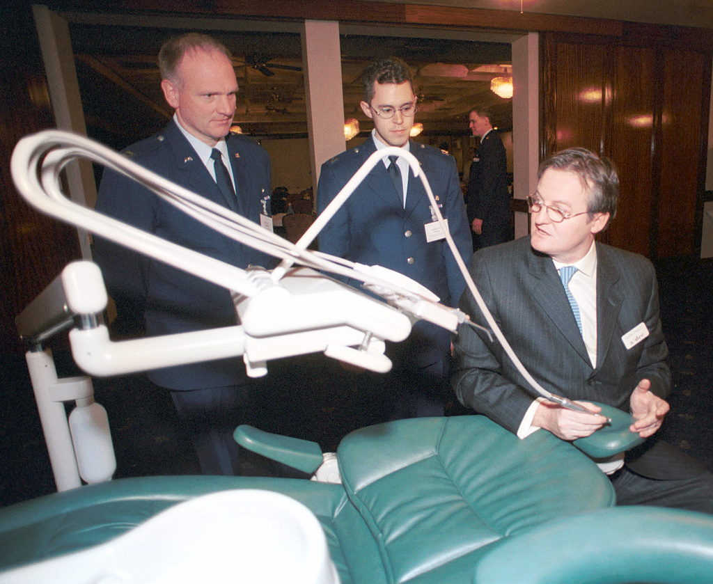 Eugene O'Malley (right), Territory Manager, A-DEC Dental UK ltd., briefs Captain Jeffery La Dine, and Captain Andrew Wilson, both from the 48th Dental Squadron, 48th Medical Group, 48th Fighter Wing, RAF Lakenheath, UK, on an innovative new chair at the sh-American Dental Continuing Education Conference. The A-DEC Radius Chair is ambidextrous, allowing right and left handed dentists to use the same chair just by rotating the tool tray around into the desired position. United States military, along with sh military and civilian medical personnel, discussed the latest dental training and new equipment. The conference is held annually at RAF Lakenheath to help maintain current...