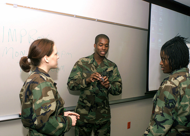 AIRMAN (AMN), Amanda Vega (left), AIRMAN First Class (A1C), Ansel Jones (center) and A1C, Kiana Jordan, all USAF conduct an improvisational scenario on underage drinking as part of the Active AIRMAN Council Professional Development Training Course at Ellsworth Air Force Base, SD. The two-day course is designed to enhance the airman's leadership skills in their assigned organizations