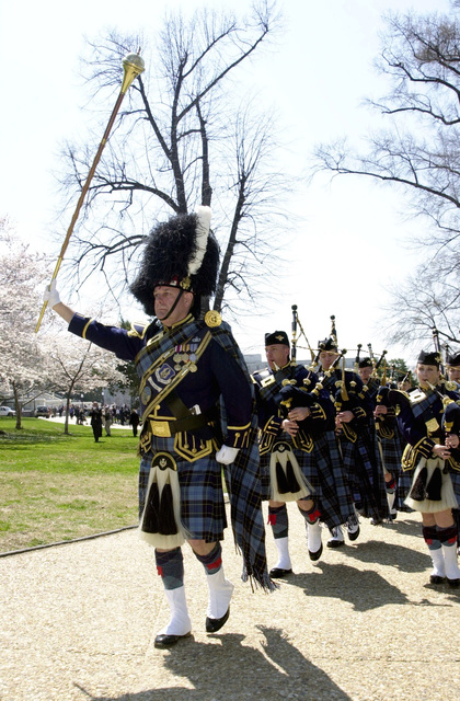 Led by Drum Major SENIOR MASTER Sergeant Jack Story the US Air Force Reserve Pipe Band from Robins Air Force Base, Georgia, march out of the Lower West Terrace of the US Capitol after the National Tartan Day Capital Ceremony. Enacted through Legislation authored by US Senator Trent Lott, Tartan Day honors the heritage of Americans of Scottish Descent. The Reserve Pipe Band is one of only two bagpipe bands in the US Armed Forces and is one of the most unique and colorful units in the Air Force. Band members wear uniforms manufactured in Scotland. Their official Tartan was authorized and approved in September 1987 by the Tartan Society in Edinburgh, Scotland