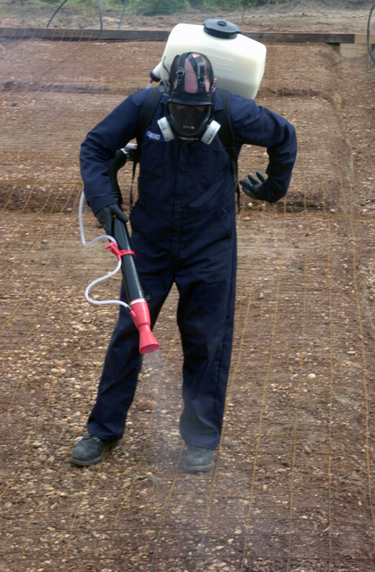 Technical Sergeant (TSGT), Thomas Guarino, USAF, Environmental Controls SPECIALIST, 823RD Red Horse Squadron, Hurlburt Field, FL sprays pesticide for cock roaches on the site where the new school is being built in Las Palmas Paraguay, during Exercise NEW HORIZONS. Under Combined Task Force Guarani Springs, joint service personnel are conducting engineering and medical operations in Paraguay, enabling required joint training. The task force will renovate, construct and improve the infrastructures of four schools and water well and also conduct three Medical Readiness Training Exercises (MEDRETS), as agreed to by the government of Paraguay