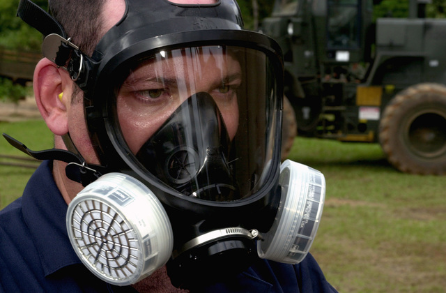 Technical Sergeant (TSGT), Thomas Guarino, USAF, Environmental Controls SPECIALIST, 823RD Red Horse Squadron, Hurlburt Field, FL dons his chemical mask prior to spraying the site for cock roaches where the new school is being built in Las Palmas Paraguay, during Exercise NEW HORIZONS. Under Combined Task Force Guarani Springs, joint service personnel are conducting engineering and medical operations in Paraguay, enabling required joint training. The task force will renovate, construct and improve the infrastructures of four schools and water well and also conduct three Medical Readiness Training Exercises (MEDRETS), as agreed to by the government of Paraguay
