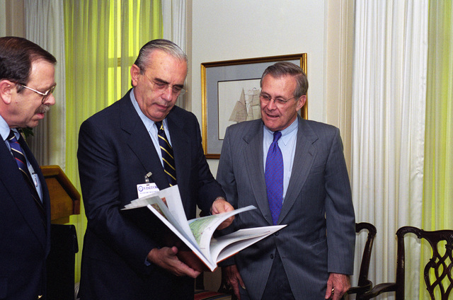 Luis Brezzo (center), Uruguay Minister of National Defense, meets with the Honorable Donald H. Rumsfeld, U.S. Secretary of Defense (SECDEF), at the Pentagon, Room 3E880, Washington, D.C., Apr. 16, 2001.  OSD Package No. 010416-D-2987S-001 TO 003 (PHOTO by Helene C. Stikkel) (Released)