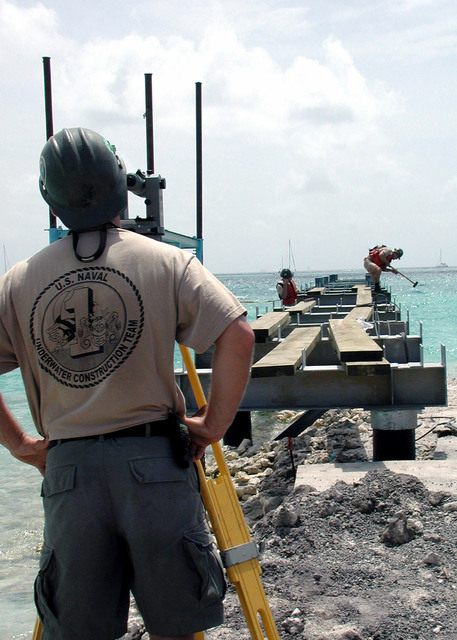 Seabees of Underwater Construction Team One (UCT1) continue progress on the new pier for the St. Vincent Coast Guard in support of NEW HORIZONS '01