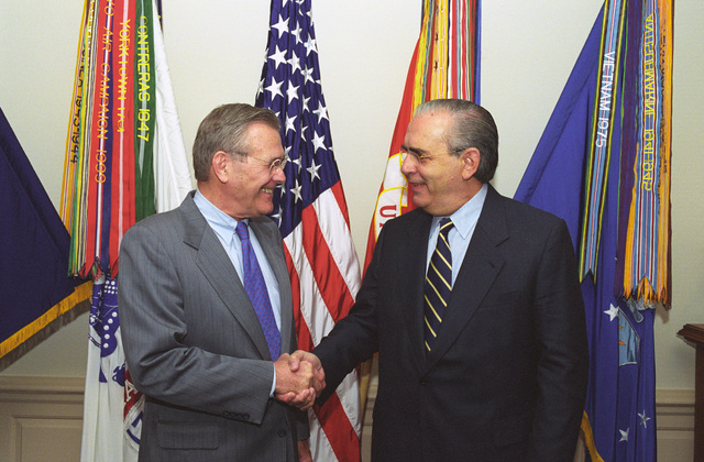 The Honorable Donald H. Rumsfeld (left), U.S. Secretary of Defense (SECDEF), shakes hands with Luis Brezzo, Uruguay Minister of National Defense, at the Pentagon, Room 3E880, Washington, D.C., Apr. 16, 2001.  OSD Package No. 010416-D-2987S-001 TO 003 (PHOTO by Helene C. Stikkel) (Released)