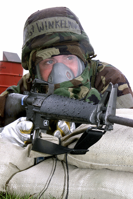 STAFF Sergeant (SSGT), Philip Winkelman, USAF Firefighter assigned to the 92ND Civil Engineers Squadron, Fairchild AFB, WA mans his bunkered position at Camp Airey, armed with a 5.56mm M16A2 assault rifle, during Operational Readiness Inspection (ORI), CRISIS REACH 01-49