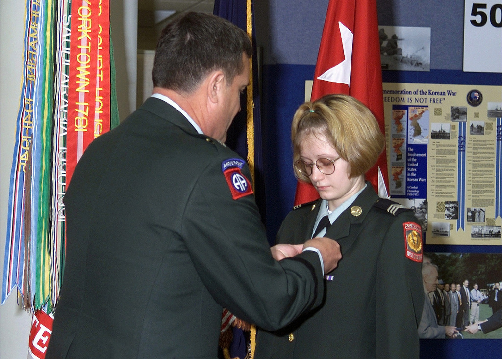 US Army (USA) Major General (MGEN) Terry Juskowiak, USA Forces Command Deputy CHIEF of STAFF for Logistics, pins the Medal of Heroism on Junior Reserve Officer Training Corps (JROTC) Cadet Corporal (CPL) Amber Parker. CPL Parker received the Medal for saving the life of a niece, by performing cardio-pulmonary resuscitation (CPR)