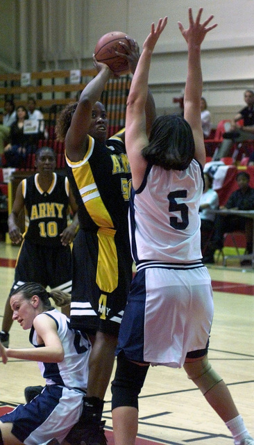 Army center Andreia Hinton takes a jump shot over Navy forward Jenna Hausvik during the 2001 Armed Forces Women's Basketball Championship held at Marine Corps Base, Quantico, Virginia, on April 26, 2001. The Army won the championship by twice defeating teams representing the Navy, Air Force and the Marine Corps